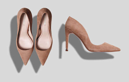 Beige suede womens shoes with high heels shot from top and from the side isolated on white