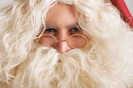 greyish: Cute Santa with greyish blue eyes and golden glasses, close up portrait