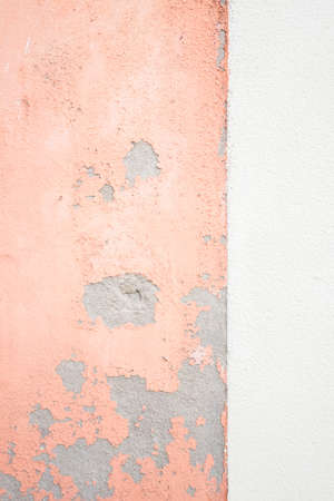 Close up texture of shabby peach and white wall background.