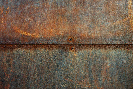 Texture of metal rusty wall with screws backround, close up view