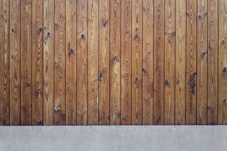 Brown wooden texture big gate background with metal base on street, close up view. Standard-Bild