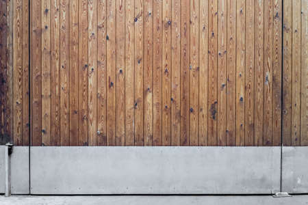 Brown wooden texture big gate background with metal base on street. Standard-Bild