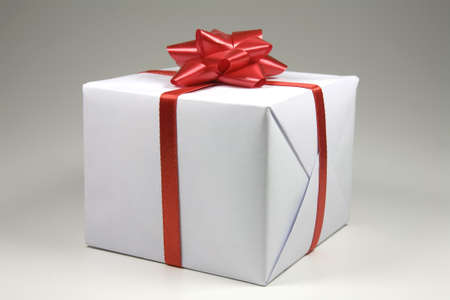 a gift white man with red ribbon Stock Photo - 6041715