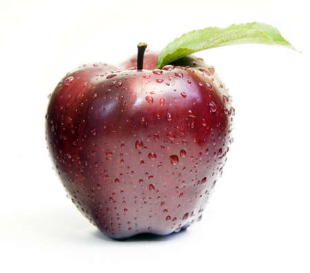 Red apple with dew drops photo