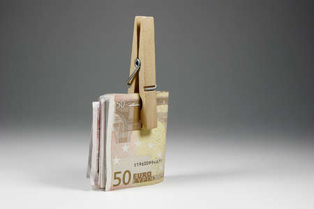 Euro banknotes held from a clamp  Stock Photo