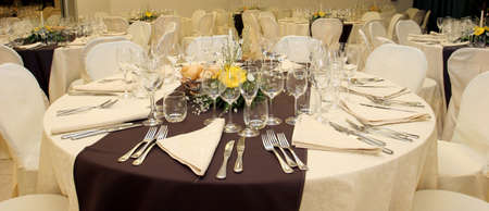 formal place setting: Table setting at a luxury wedding reception  Stock Photo