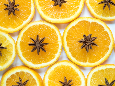 Abstract background with citrus fruit of orange slices and star anise