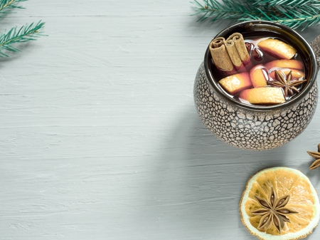 Christmas mulled wine with cinnamon, orange and anise in a ceramic bucket,