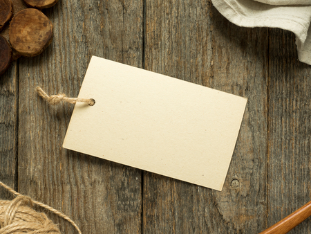 Paper notes on a rope on a wooden background. Copy space. 版權商用圖片