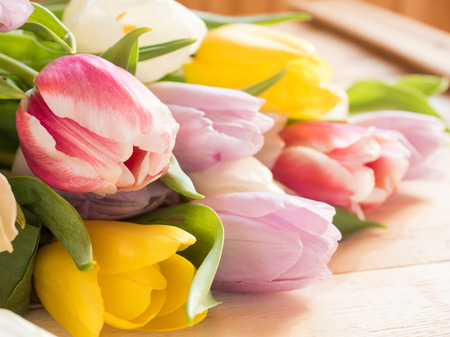 Bouquet of colorful tulips on wooden background Stock Photo