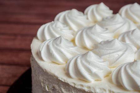 Delicious light ice cream cake with roses cream.