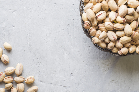 Delicious salted pistachios on a plate Copy space