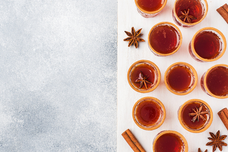 Mulled wine cider in small stacks with cinnamon and anise.