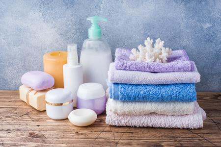 Towels cream soap and bath accessories