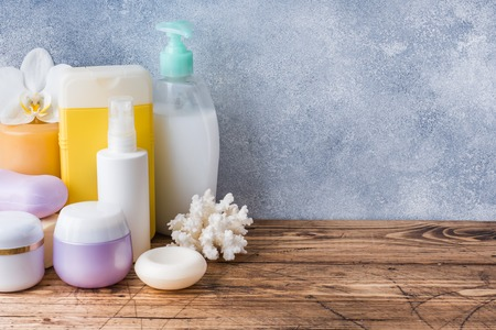 Towels cream soap and bath accessories