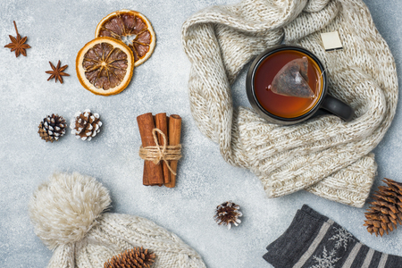 Winter vacation concept. Warm clothes, Cup of hot tea with fragrant spices
