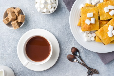 Pieces of delicious pumpkin pie with marshmallow and nuts on a plate
