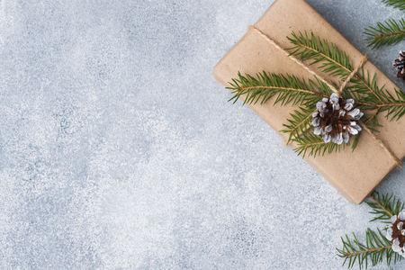 Wrapped gift for Christmas on a gray background with copy space. The concept of Christmas and New Year