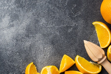 Pieces of fresh orange juice on a dark background. Copy space Stock Photo