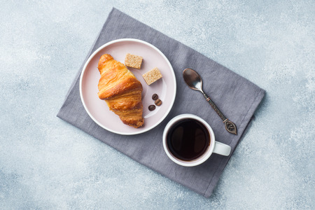 Breakfast croissants on a plate and a Cup of coffee on the table, copy space Stock fotó