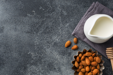 Almonds in a bowl and milk on the table. Selective focus. Copy space 스톡 콘텐츠