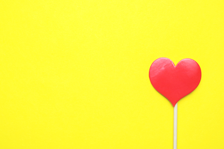 Valentines day concept. Red hearts on yellow background. Copy space