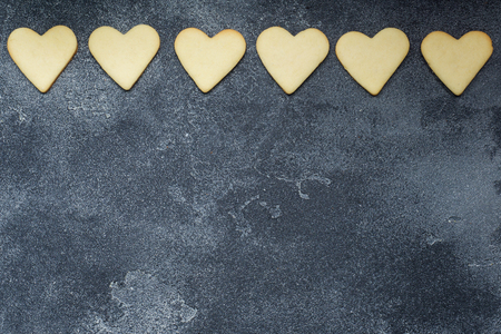 Heart shaped cookies for valentine's day on dark background. Copy space.
