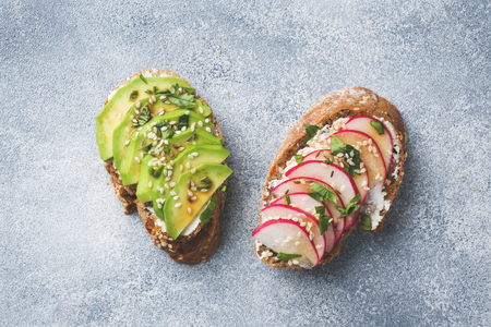 Cereal bread sandwiches with cottage cheese, fresh avocado and radish