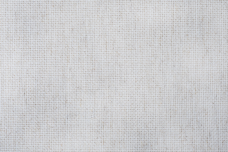 Fabric canvas for cross stitch crafts. Texture of cotton fabric