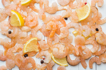 Shrimp with spices and lemon on the table Stock Photo