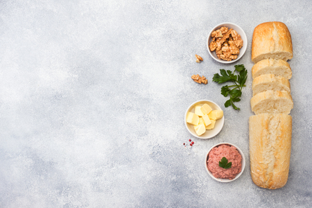 Products for cooking a sandwich. Chicken pate and butter, nuts and parsley Banco de Imagens