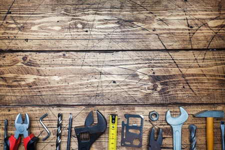 Set of different repair tools on wooden background with copy space Stock fotó