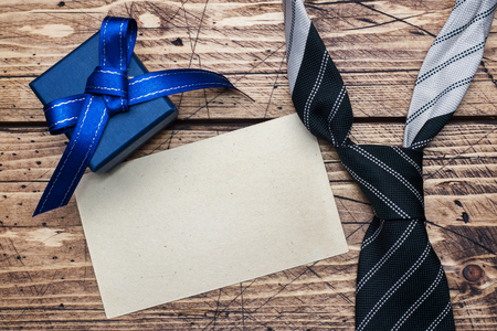 Father's Day Concept. Striped tie and a gift on wooden  with copy space Stockfoto
