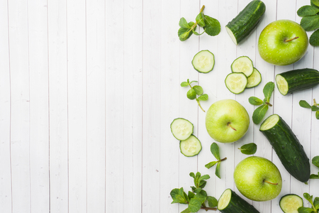 Green cucumber mint Apple on the table. The concept of diet and vegetarianism. Copy space