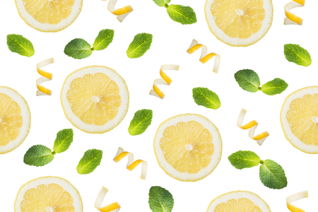 Seamless pattern of Round slices of lemon, shavings of lemon zest and mint leaves on a white background. Isolate