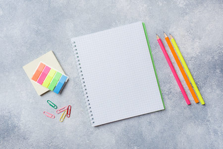 School supplies, notebooks pencils on grey background with copy space