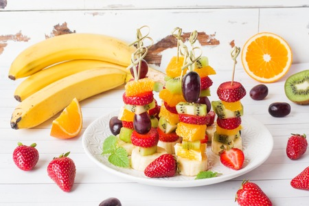 Fresh fruit on skewers. Concept buffet for a summer party
