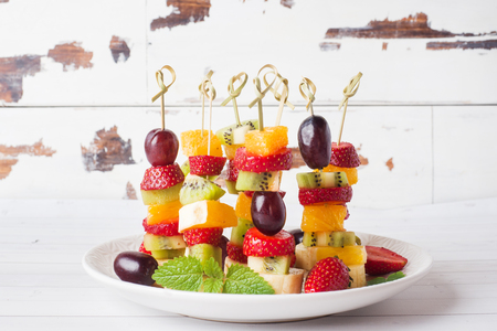 Fresh fruit on skewers. Concept buffet for a summer party Copy space Banco de Imagens