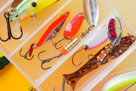 Fishing hooks and bait in a set for catching different fish Stock Photo