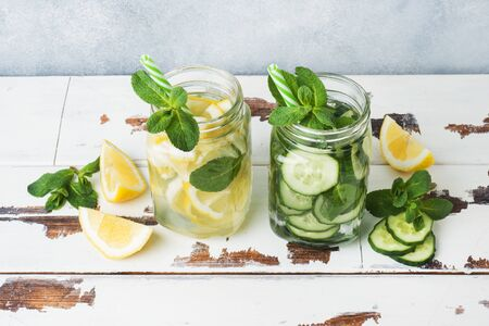 Detox water for healthy lifestyle. Fresh water in jar with lemon, cucumber and mint on wooden table 写真素材