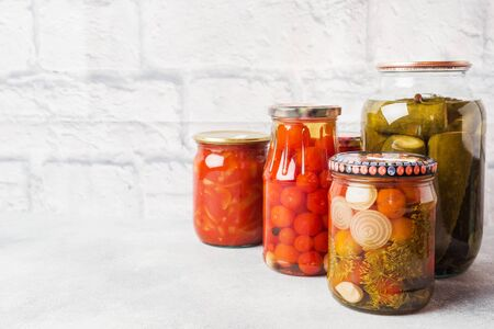 Preservation of vegetables in banks. Fermentation products. Harvesting cucumbers and tomatoes for the winter Copy space