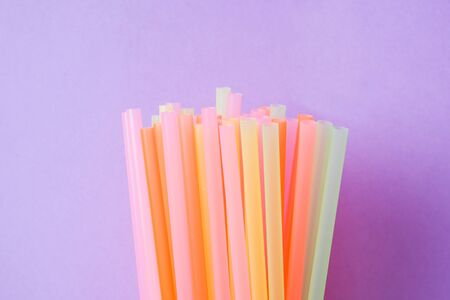 Abstract a colorful of plastic straws used for drinking water or soft drinks. Selective focus. Copy space.