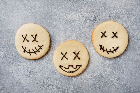 Homemade cookies for Halloween. Cookies with funny faces and spider webs