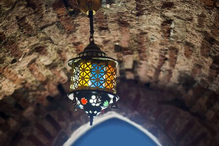 Vintage antique lamp on the brick wall of the fortress