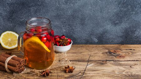 Drink from wild rose berries with lemon and honey cinnamon. Vitamin useful decoction of rose hips. Copy space. Stockfoto