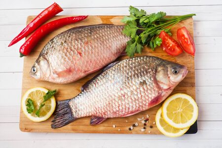 Raw carp fish with spices and vegetables for cooking. The view from the top. Copy space