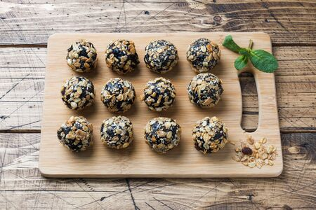 Healthy energy balls made of dried fruits and nuts with oatmeal and muesli . Raw vegan candy
