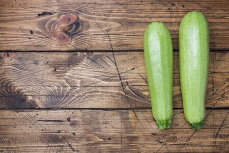 Fresh raw zucchini ready to eat on wooden background with copy space Banco de Imagens - 133052861