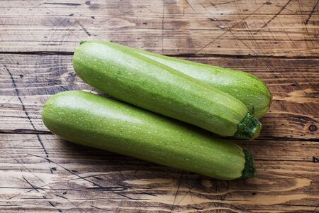 Fresh raw zucchini ready to eat on wooden background with copy space Banco de Imagens - 133053903
