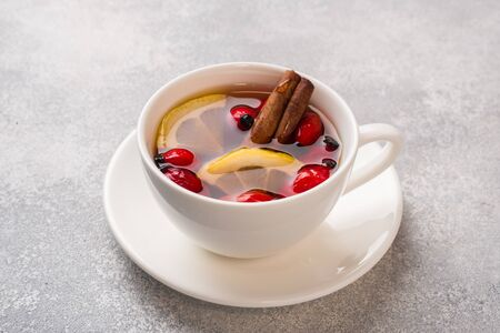 Drink from wild rose berries with lemon and honey cinnamon. Vitamin useful decoction of rose hips Copy space Фото со стока